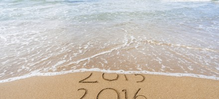 2015 fading into 2016 on the beach with ocean coming in