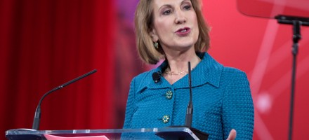 photo of Carly Fiorina Republican Presidential candidate speaking at podium into microphones