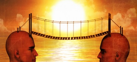 illustration of 2 opposite facing heads connected by a bridge over the water at sunrise