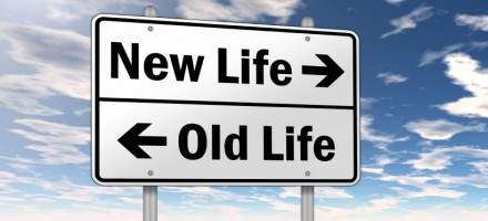 Road sign showing new life vs old life.